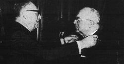 Jean Oudinot , remis de son attentat, est decore par Maurice Schumann au grade de Commandeur de l'Ordre du Merite National